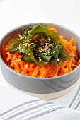 Grated carrot with wakame and sesame seeds