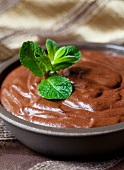Chocolate mousse with mint leaves