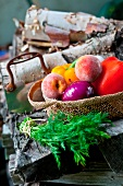 Fresh Veggies and Fruit in a Basket; Bunch of Fresh Dill; On a Woodpile