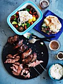 Lamb skewers with a yogurt, tahini and garlic sauce, pita bread and Greek salad