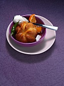 Rum baba with mandarins and cream