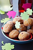 Mini doughnuts with paper New Year's decorations