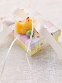 An Easter parcel with a fondant chick and a sugar egg