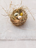 An Easter nest with marzipan and sugar eggs