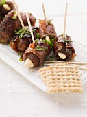 Date skewers with dry-cured ham and almonds