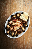 Mussels, chorizo and scallops in a white wine and saffron broth served with foccacia