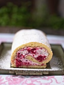 Sponge roll with raspberries