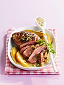 Duck breast with green peppercorns and cider