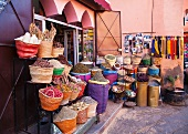 Baskets full of spices in front of a shop in Marrakesh, Morocco
