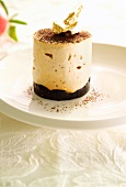 Quark mousse with chocolate and gold leaf