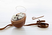 Chocolate mousse with cream and mocha beans