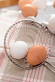 Boiled eggs in a draining spoon