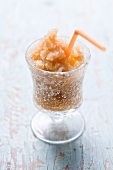 Melon granita in a glass with a drinking straw