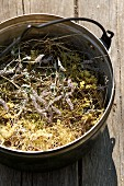Dried herbal hay in a metal pot