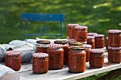 Bottled tomato sauce in screw-top jars