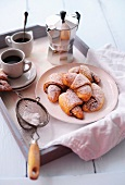 Croissants with icing sugar and coffee