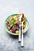 Lentil salad with grapes and confit of duck