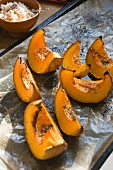 Baked wedges of squash with seasoning salt, served with rice
