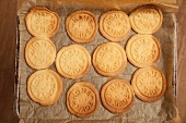 Biscuits stamped with 'home made', on a baking tray (view from above)