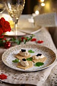 Crackers topped with smoked salmon and prawn mousse and caviar for Christmas dinner