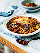 Braised duck with bacon and beans