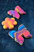 Colourful butterfly and flower biscuits