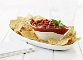 Tomato salsa and yoghurt dip with multi-grain tortilla chips