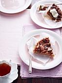 Two slices of pecan pie on dessert plates