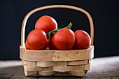 Tomatoes on the vine, in a basket