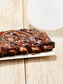 Barbecued beef ribs with barbecue sauce