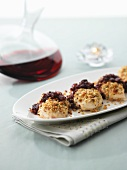 Oven-baked chicken breast topped with Stilton breadcrumbs and cranberries