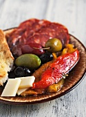 Antipasto with Fire Roasted Red and Yellow Peppers, Mixed Olives, Provolone Cheese, Sopressata and Italian Bread