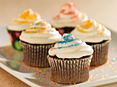 Chocolate Cupcakes with Vanilla Frosting and Colored Sugar Crystals; On a Platter