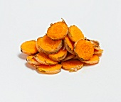 Sliced Turmeric Root Piled on a White Background