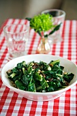 Cooked chard with pine nuts and raisins