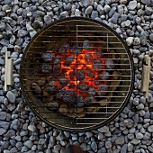A barbeque with glowing coals