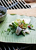 Fish with Asian marinade on a banana leaf