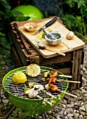 Prawn kebabs with lemon halves on the barbecue