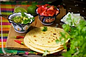 Tortillas, avocado, tomatoes and onions
