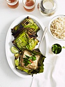 Barbecued fish wrapped in banana leaves