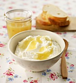 Quark with pineapple and orange sauce