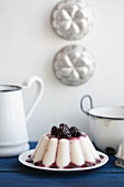 Semolina pudding with blackberry sauce