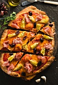 Pancetta, Artichoke and Olive Pizza; Sliced