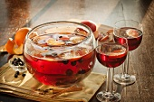 Fruity Punch with Cinnamon Sticks in a Punch Bowl and Glasses