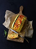 Tapas cake with courgette on a chopping board