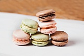 Assorted Macaroons Stacked on Wax Paper