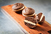 Whoopie Pies on a Wooden Board; One Halved