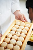 Chef Holding a Platter of Macaroons