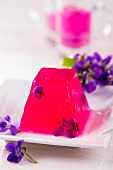 Violet jelly with fresh violet flowers