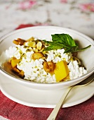 Cottage cheese with mango, passion fruit, cashew nuts and mint